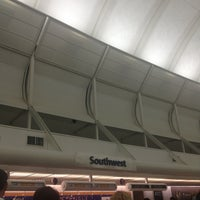 Photo taken at Southwest Ticket Counter by Corinna H. on 7/4/2013
