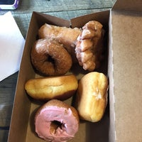 Photo taken at Square Donuts by Amy G. on 10/10/2014