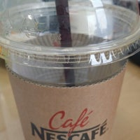 Photo taken at Café NESCAFÉ by KEY on 4/2/2014