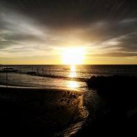 Photo taken at Layang-layangan Beach by Zunaidi Yum Y. on 4/13/2013
