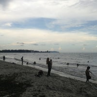 Photo taken at Pantai Cahaya Negeri (Beach) by Raissa V. on 6/8/2013
