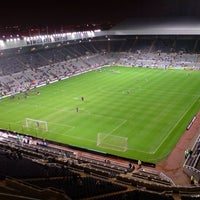 Photo taken at St James' Park by Simon N. on 10/10/2013