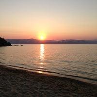 Photo taken at Mandraki beach by Eleanna K. on 8/13/2013