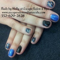 Photo taken at Escape Salon by Holly F. on 8/15/2013