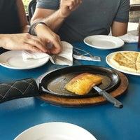 Photo taken at Atheneos Greek Village Cafe by Cody W. on 6/24/2014