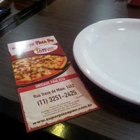 Photo taken at Super Pizza Pan by Diego L. on 3/14/2013
