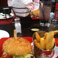 Photo taken at Red Robin Gourmet Burgers by Stephanie A. on 5/25/2013