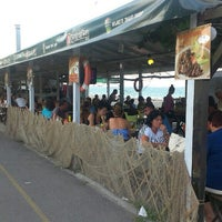 Photo taken at Капаните (The small seafood restaurants by the beach) by Kaptan Tahir T. on 7/25/2015
