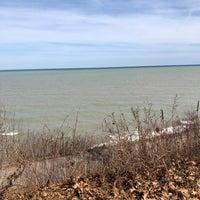 Photo taken at Big Bay Beach by Tim C. on 3/25/2018