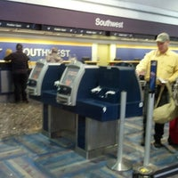 Photo taken at Southwest Airlines Ticket Counter by Kevin G. on 3/12/2013