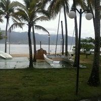 Photo taken at Praia do Perequê by Ana Claudia M. on 1/26/2013