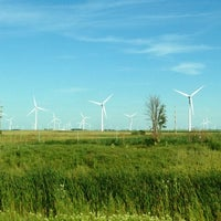 Photo taken at Windmill farm by Mary Ann G. on 8/1/2013