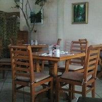 Photo taken at Island Palm Grill & Bar by Stella B. on 6/2/2013