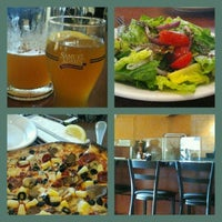 Photo taken at Amici's East Coast Pizzeria by Stella B. on 5/31/2013