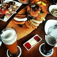 Photo taken at Brotzeit German Bier Bar & Restaurant by YVit on 1/11/2014