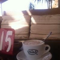 Photo taken at Mondo Cafe by Mutaz G. on 9/23/2014