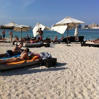 Photo taken at Barasti Beach by Susana F. on 11/14/2012