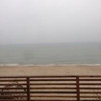 Photo taken at Nidos centrinis pliazas/ Nida Beach by Genadijus S. on 1/3/2014