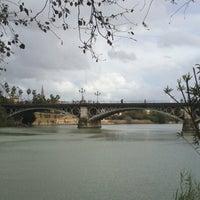 Photo taken at Isabel II Bridge 'Triana Bridge' by Isa on 3/9/2013