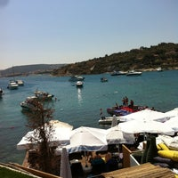 Photo taken at KafePi Beach Club by Erkan on 8/25/2013