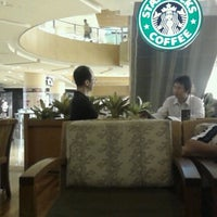 Photo taken at Starbucks by Marvely N. on 12/24/2012