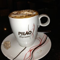 Photo taken at Viena Café by Renato J. on 10/7/2012