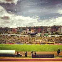 Photo taken at Estadio Olimpico Atahualpa by Pancho T. on 9/23/2012