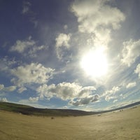 Photo taken at Woolacombe Beach by Patricia Nikki on 10/5/2013