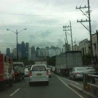 Photo taken at Ortigas & Greenmeadows Avenue Intersection by Jeki M. on 8/22/2014