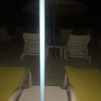 Photo taken at Over Seas Beach & Lounge by Deniz K. on 6/19/2014
