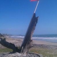 Photo taken at Palm Beach Park - Poche Beach by Clint K. on 3/9/2013