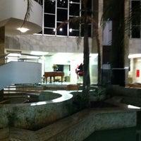 Photo taken at Carlton Hotel by Gilmar on 10/5/2012