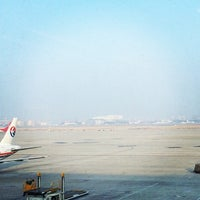 Photo taken at Gate 73 by Rees A. on 1/19/2014