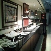 Photo taken at Emirates Lounge by Ron B. on 12/23/2012