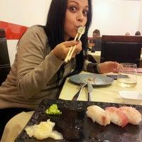 Photo taken at Hong Ye Wok Sushi by Elisa C. on 10/30/2012