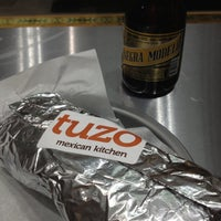 Photo taken at Tuzo Mexican Kitchen by Neil D. on 12/11/2012