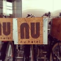 Photo taken at NU Hotel by David K. on 10/9/2012