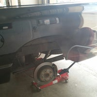 Photo taken at Discount Tire by Luis C. on 6/12/2014