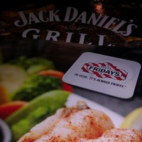 Photo taken at T.G.I. Friday's by Reggie A. on 12/31/2012
