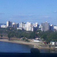 Photo taken at Puente General Belgrano by Mauro O. on 10/18/2012