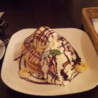 Photo taken at T's cafe-note by Masami H. on 11/20/2012