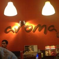 Photo taken at Aroma Café by Malek S. on 5/23/2013