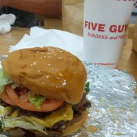 Photo taken at Five Guys by Vicente R. on 10/25/2012