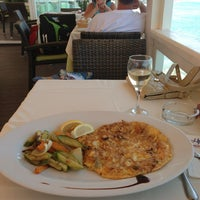 Photo taken at Palmera Seaside Restaurant by Мария on 7/13/2013