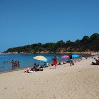Photo taken at Mandraki beach by Elia V. on 8/20/2014