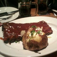 Photo taken at Outback Steakhouse by Isabella A. on 2/10/2013