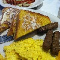 Photo taken at Monrovian Family Restaurant by Erik S. on 5/18/2014