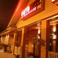 Photo taken at Outback Steakhouse by Gabi F. on 3/4/2013