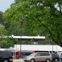 Photo taken at Fort Totten Metro Parking Lot by Kim G. on 5/12/2014