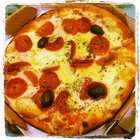 Photo taken at Delluccio Pizza Bar by Israel O. on 6/4/2013
